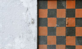 Abstract orange black   background  patter wall. Wall  paint is peeling off Royalty Free Stock Images