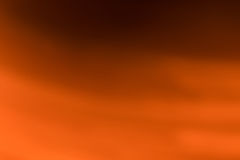 Abstract orange blurred background. Created by light movement Royalty Free Stock Images