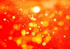 Abstract orange bokeh and glitter background. Abstract orange bokeh and golden glitter background Royalty Free Stock Photo
