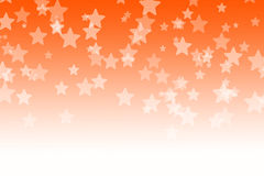 Abstract orange bokeh stars background.  Royalty Free Stock Photo