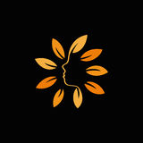 abstract orange color floral logo. Round shape flowers with petals logotype. Stock Photo