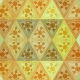 Abstract orange color geometric background . Triangle shapes in yellow transparent stained glass with embroidery effect. Orange color geometric background royalty free stock photo