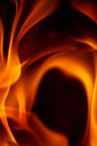Abstract orange fiery wave background. Abstract background with bright flames on black Royalty Free Stock Image