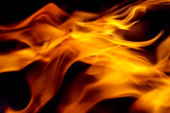 Abstract orange fiery wave background. Abstract background with bright flames on black Royalty Free Stock Photography