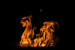 Abstract flame. Fire element on the black background. Stock Photography
