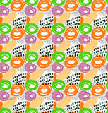 Abstract orange green and purple circles with black dots. Hand drawn with paint brush seamless background.Modern hipster style design Stock Illustration
