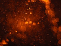 Abstract orange grunge Christmas background. Festive elegant abs. Tract background with bokeh lights Royalty Free Stock Photography