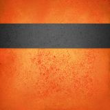 Abstract orange halloween background template with black textured stripe or ribbon Royalty Free Stock Images