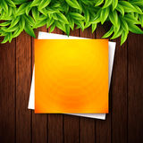 Abstract orange note paper on wooden background and leaves for y Stock Photos