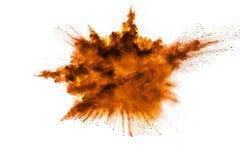 Abstract orange powder explosion on white background. stock photo