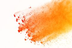 Abstract orange powder splashed on white background. Colorful po royalty free stock photos