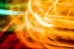 Abstract orange, red, green blurred background. Created by light movement Stock Photography
