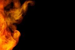 Abstract orange smoke hookah on a black background. Stock Photo