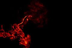 Abstract orange smoke hookah on a black background. Royalty Free Stock Images
