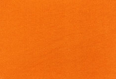 Abstract orange textile texture. Royalty Free Stock Images