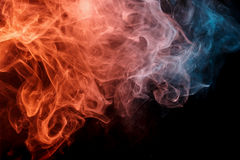 Abstract orange turquise smoke Weipa. Abstract smoke Weipa. Personal vaporizers fragrant steam. The concept of alternative non-nicotine smoking. Orange turquise Stock Photos