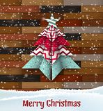Abstract origami christmas tree on wooden background. Abstract origami christmas tree on brown wooden parquet background, vector illustration, eps 10 with stock illustration