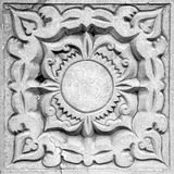 Abstract ornament, bas-relief. Abstract sun ornament, a stone bas-relief on the wall Stock Images