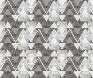 Abstract ornament from gray triangles and spirals. In white, gray and dark gray colors the seamless pattern on gray background Royalty Free Stock Photo