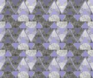 Abstract ornament from gray triangles and spirals. In white, gray, purple and dark gray colors the seamless pattern on gray background Royalty Free Stock Photo