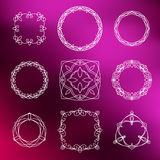 Abstract ornamental lace frames set  on purple background. For use in design Stock Image