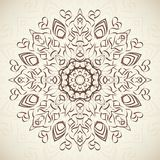 Abstract ornamental round floral lace pattern on. Beige background. Vector illustration for holiday design. For decorating of wedding invitations, greeting Stock Photography