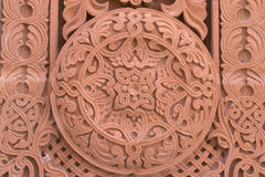 Abstract ornamnet carved on red stone - armenian church. Abstract ornamnet carved on red stone in armenian church stock images