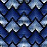 Abstract ornate knitting seamless pattern in blue hues. Abstract ornamental knitting seamless vector pattern as a knitted fabric texture with various transition Royalty Free Stock Images