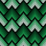 Abstract ornate knitting seamless pattern in green hues. Abstract ornamental knitting seamless vector pattern as a knitted fabric texture with various transition Stock Photos