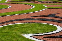 Abstract outdoor composition of curves in the lawn Stock Photos