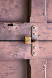abstract  padlock rusty brass brown  closed wood door crenna gal Stock Photography