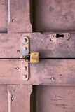 abstract  padlock rusty brass brown  closed wood door crenna Royalty Free Stock Photography