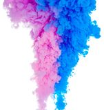 Abstract paint background color of blue and pink ink splash in the water isolated on white background. Abstract paint background colored of blue and pink ink stock image