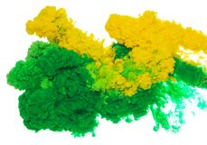 Abstract paint background color of green and yellow ink splash in the water isolated on white background. Abstract paint background colored of green and yellow royalty free stock images
