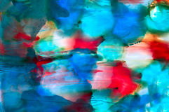 Abstract paint blue res spots smudged. Colorful background hand drawn with bright inks and watercolor paints. Color splashes and splatters create uneven Royalty Free Stock Photography