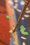 Abstract of Paint brush painting. Paint Brush with hand on painting Stock Image