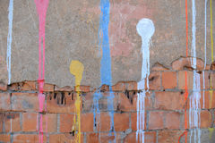 Abstract paint drips on concrete wall after paintball Royalty Free Stock Photography