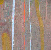 Abstract paint drips on concrete wall after paintball. Playing Stock Images