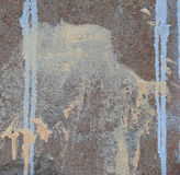 Abstract paint drips on concrete wall. After paintball playing Stock Image