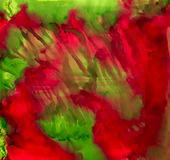 Abstract paint light green red smudged. Colorful background hand drawn with bright inks and watercolor paints. Color splashes and splatters create uneven Royalty Free Stock Photo