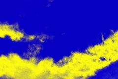 Abstract paint splash background. Yellow lemon color on the ultramarine blue background. Copy space stock photos