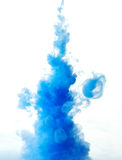 Abstract paint splash. Abstract splash of blue paint isolated on white background stock photography
