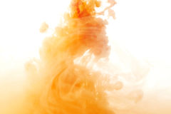 Abstract paint splash. Abstract splash of orange paint isolated on white background royalty free stock image
