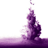 Abstract paint splash. Abstract splash of purple paint isolated on white background stock image