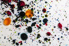 Abstract Paint Splatter. Multicolored paint dye splattered into shallow water creates a colorful and interesting pattern Royalty Free Stock Photography