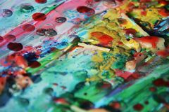 Abstract paint texture with colorful shapes, wax like structure. Abstract texture with shapes and forms, wax structure in orange, blue, green, yellow and Royalty Free Stock Image