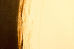 Abstract painted background in golden brown Royalty Free Stock Photos