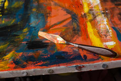 Abstract painted canvas. Oil paints on a palette. Stock Image
