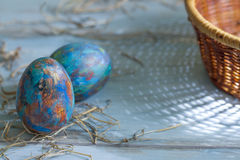 Abstract painted Easter eggs and morning light on blue Stock Image