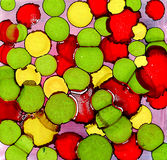 Abstract painted green yellow red spots. Colorful background hand drawn with bright inks and watercolor paints. Color splashes and splatters create uneven Stock Images
